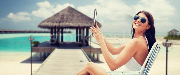 улыбающаяся женщина солнечные ванны пляж Летние каникулы туризма Сток-фото © dolgachov