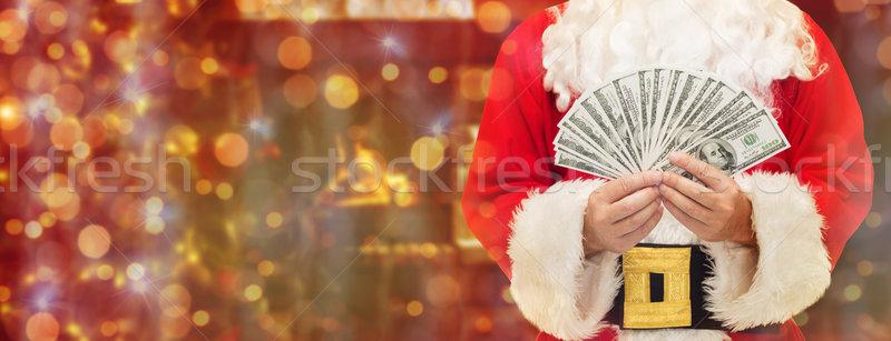 close up of santa claus with dollar money Stock photo © dolgachov