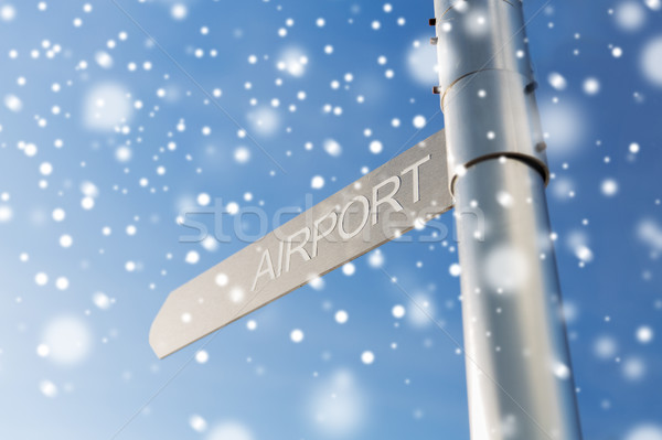 Stock photo: close up of airport signpost over blue sky