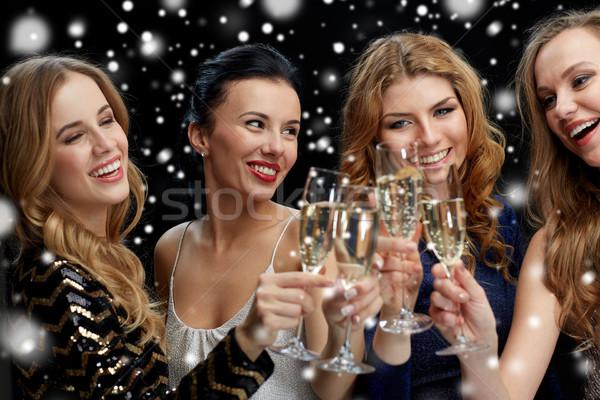 Feliz mulheres champanhe óculos preto celebração Foto stock © dolgachov