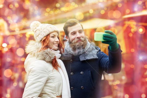 пару смартфон старый город праздников зима Сток-фото © dolgachov