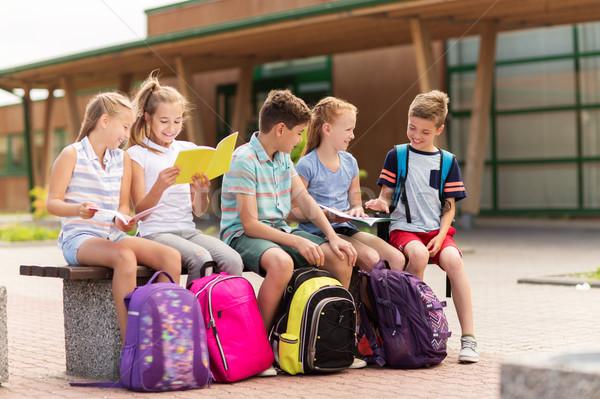 group of happy elementary school students outdoors Stock photo © dolgachov