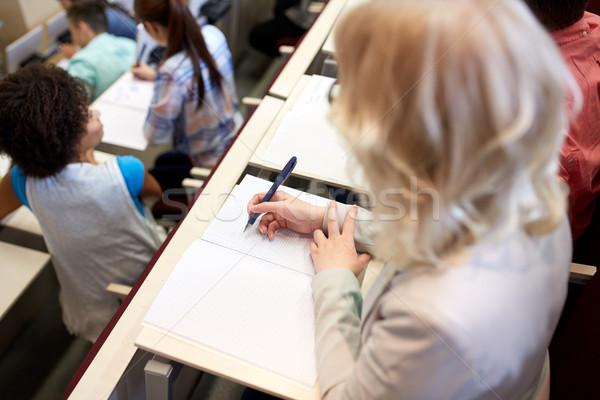Estudante escrita caderno exame palestra educação Foto stock © dolgachov
