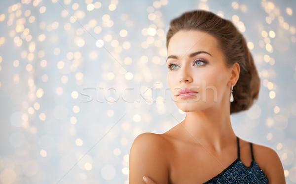 woman in evening dress and diamond earring Stock photo © dolgachov