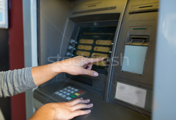 close up of hands choosing option on atm machine Stock photo © dolgachov