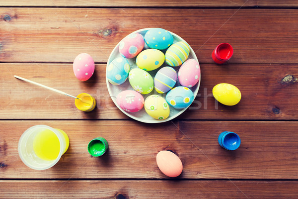 Stock photo: close up of colored easter eggs on plate