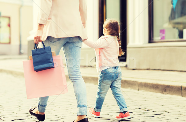 close up of mother and child shopping in city Stock photo © dolgachov
