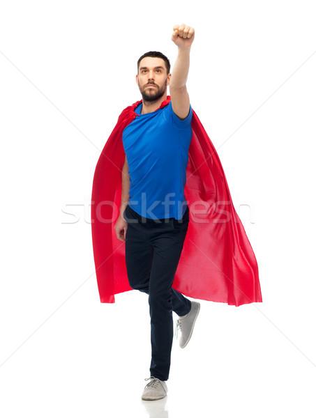 man in red superhero cape Stock photo © dolgachov