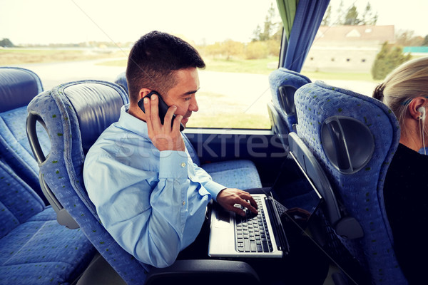 man with smartphone and laptop in travel bus Stock photo © dolgachov