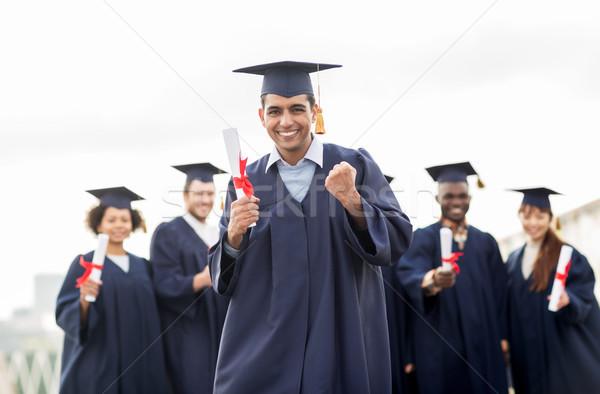 Feliz estudante diploma graduação educação Foto stock © dolgachov