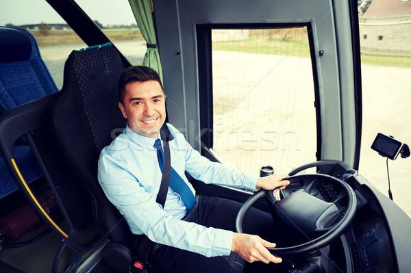 happy driver driving intercity bus Stock photo © dolgachov