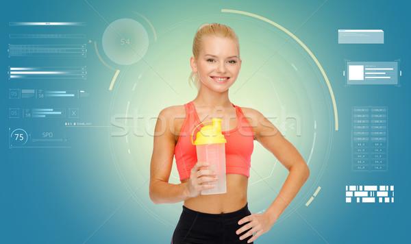 Mosolyog sportos nő shaker üveg fitnessz Stock fotó © dolgachov