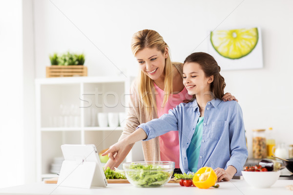 family cooking dinner using tablet pc at kitchen Stock photo © dolgachov