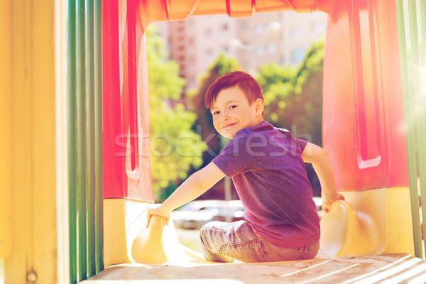 Heureux peu garçon slide enfants aire de jeux Photo stock © dolgachov