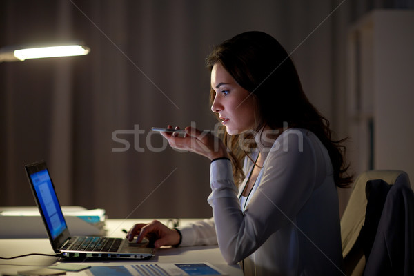 woman using voice command recorder on smartphone Stock photo © dolgachov