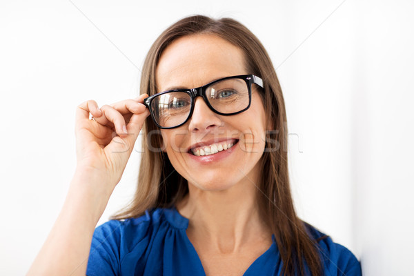Stock photo: happy smiling middle aged woman in glasses