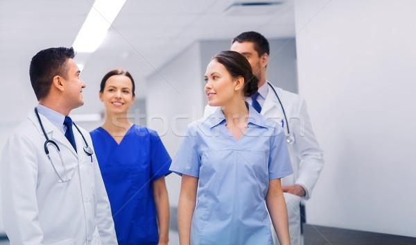 Szczęśliwy grupy lekarzy szpitala kliniki zawód Zdjęcia stock © dolgachov
