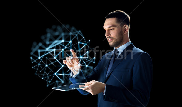 businessman with tablet pc and low poly projection Stock photo © dolgachov