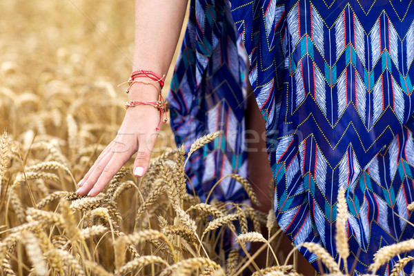 close up of young hippie woman on cereal field Stock photo © dolgachov