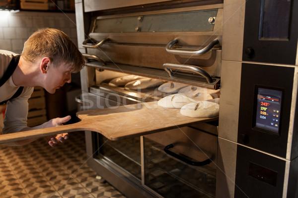 Baker pain four boulangerie alimentaire cuisson Photo stock © dolgachov