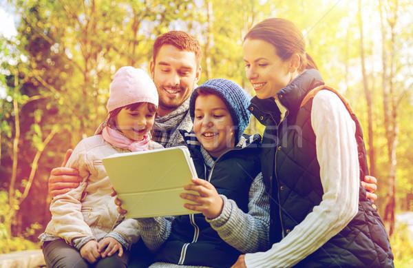happy family with tablet pc at camp Stock photo © dolgachov