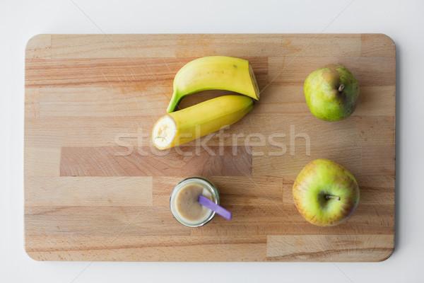 jar with fruit puree or baby food Stock photo © dolgachov