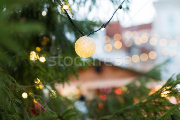 close up of christmas tree garland bulb outdoors Stock photo © dolgachov