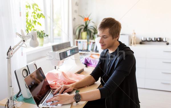 fashion designer with laptop working at studio Stock photo © dolgachov