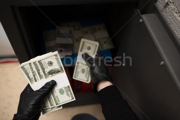 Ladrão dinheiro seguro cena do crime roubo Foto stock © dolgachov