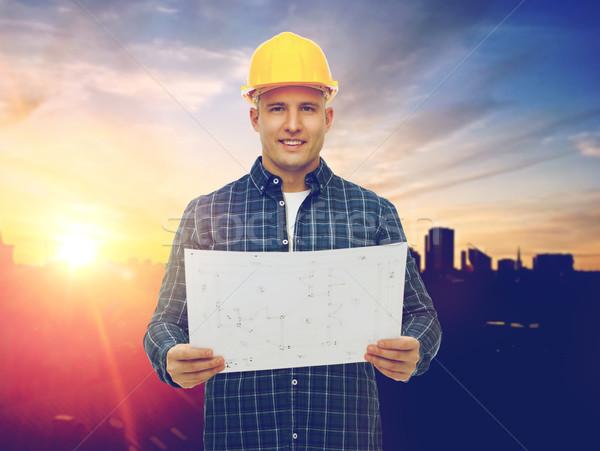 Férfi építész citromsárga védősisak terv építkezés Stock fotó © dolgachov