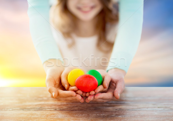close up of girl and mother holding easter eggs Stock photo © dolgachov