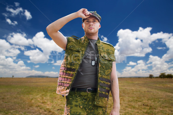 soldier in military uniform over sky background Stock photo © dolgachov