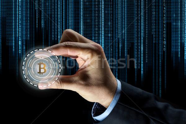 Közelkép üzletember kéz bitcoin hologram pénzügy Stock fotó © dolgachov