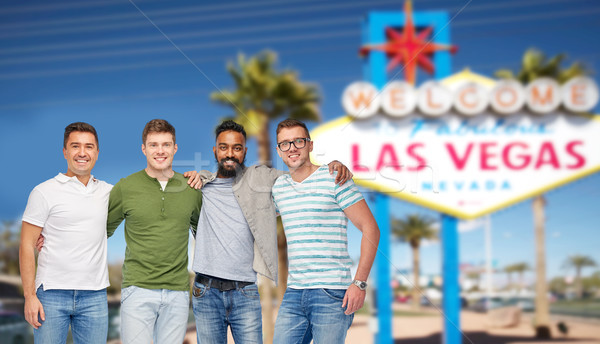 international male friends at las vegas Stock photo © dolgachov
