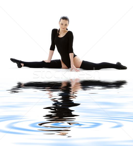 fitness in black leotard on white sand #6 Stock photo © dolgachov