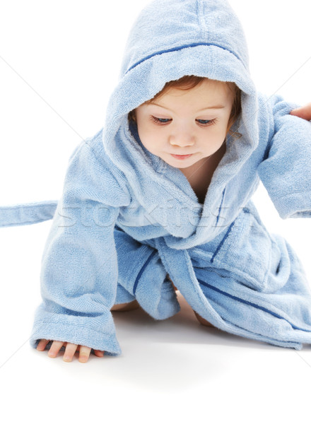 Baba fiú kék köntös kúszás fehér Stock fotó © dolgachov