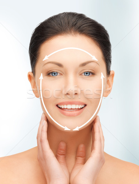 Stock photo: face and hands of beautiful woman