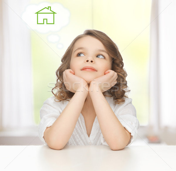 girl dreaming about the house Stock photo © dolgachov