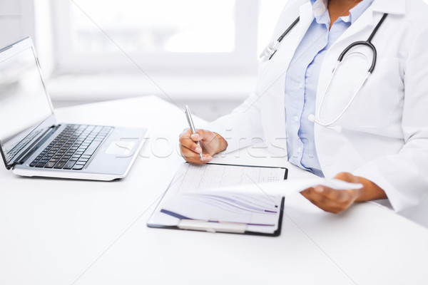 female doctor writing prescription Stock photo © dolgachov