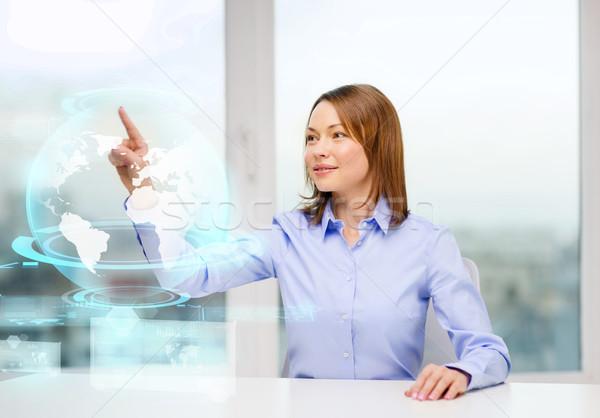笑顔の女性 ポインティング 地球 ホログラム ビジネス 教育 ストックフォト © dolgachov