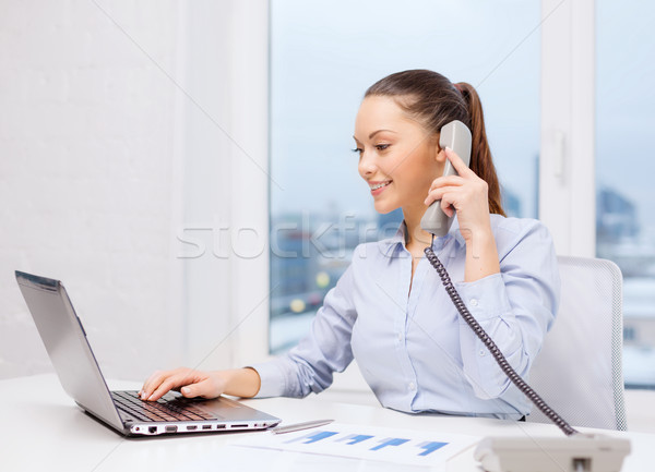 businesswoman with phone, laptop and files Stock photo © dolgachov