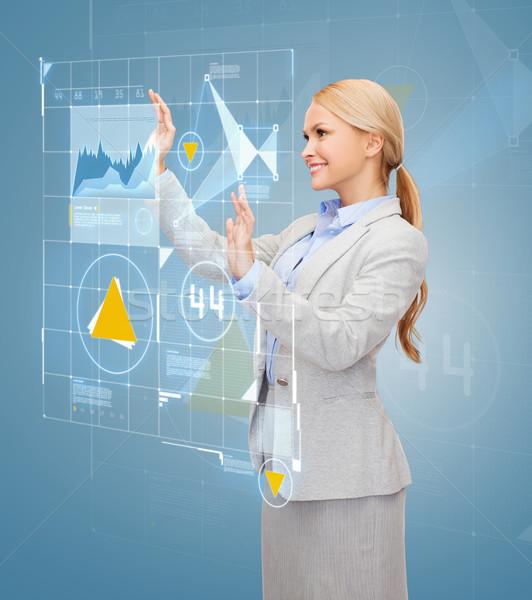 улыбаясь деловая женщина рабочих виртуальный экране бизнеса Сток-фото © dolgachov