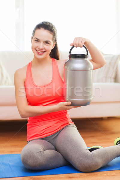Sorridente jarra proteína casa fitness Foto stock © dolgachov