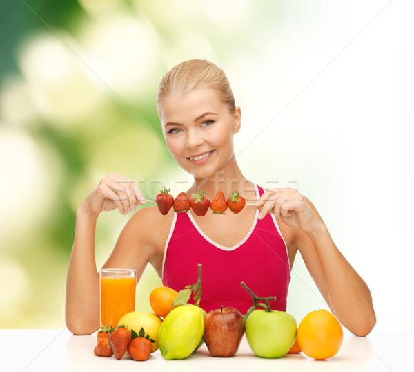 Mosolyog fiatal nő bioélelmiszer asztal fitnessz diéta Stock fotó © dolgachov