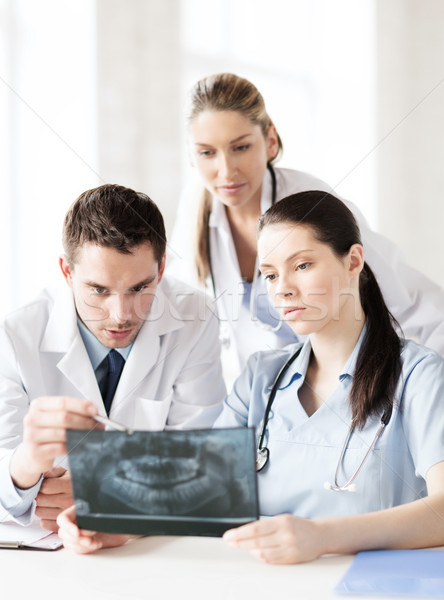 group of doctors looking at x-ray Stock photo © dolgachov