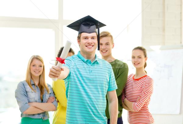 Mosolyog férfi diák diploma oktatás emberek Stock fotó © dolgachov