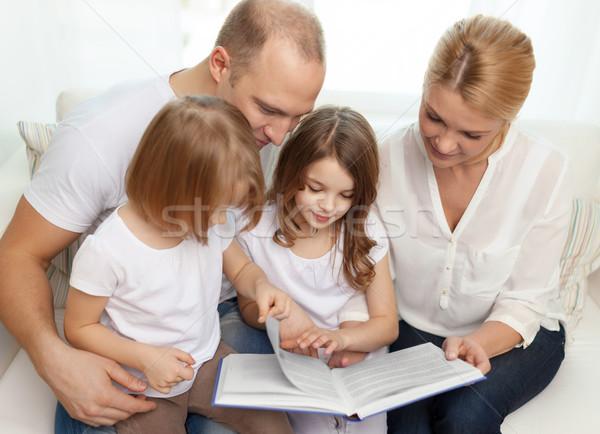 Mosolyog család kettő kislányok könyv gyermek Stock fotó © dolgachov