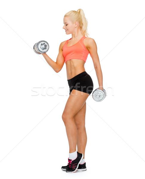 Mosolyog sportos nő nehéz acél súlyzók Stock fotó © dolgachov