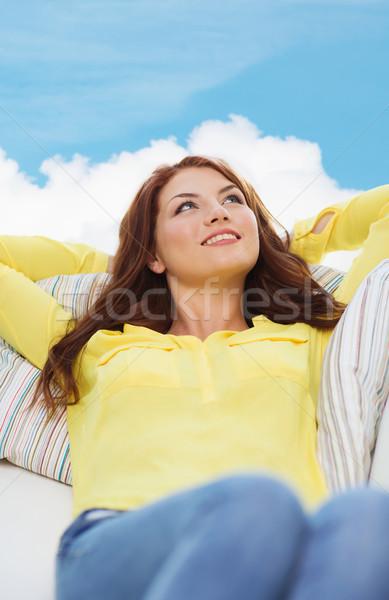 Sonriendo sofá casa felicidad mujer Foto stock © dolgachov