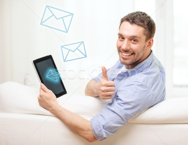 Sorridente homem trabalhando casa tecnologia Foto stock © dolgachov